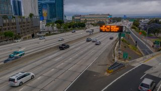 Traffic moves on a freeway near downtown Los Angeles.