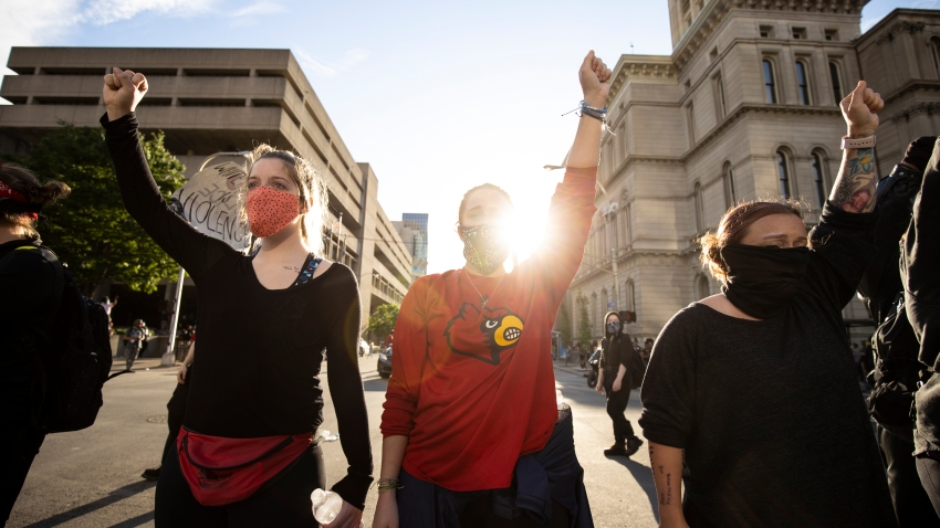 In this May 29, 2020, file photo, protesters gather outside of City Hall after a peaceful march across the city in Louisville, Kentucky.