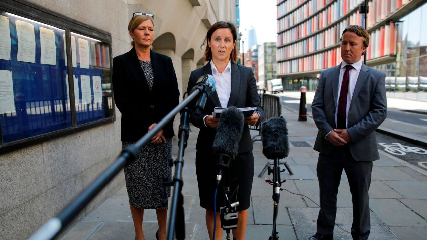 Metropolitan police press officer Melanie Pressley (C) gives a statement outside the Old Bailey on behalf of the family of the victim, in London on June 26, 2020, after a troubled British teenager who threw the six-year-old French boy off a viewing platform at London's Tate Modern art gallery last year was jailed for life. Judge Maura McGowan told Jonty Bravery, 18, he would spend at least 15 years in custody for attempting to murder the boy in front of horrified crowds on August 4 last year.