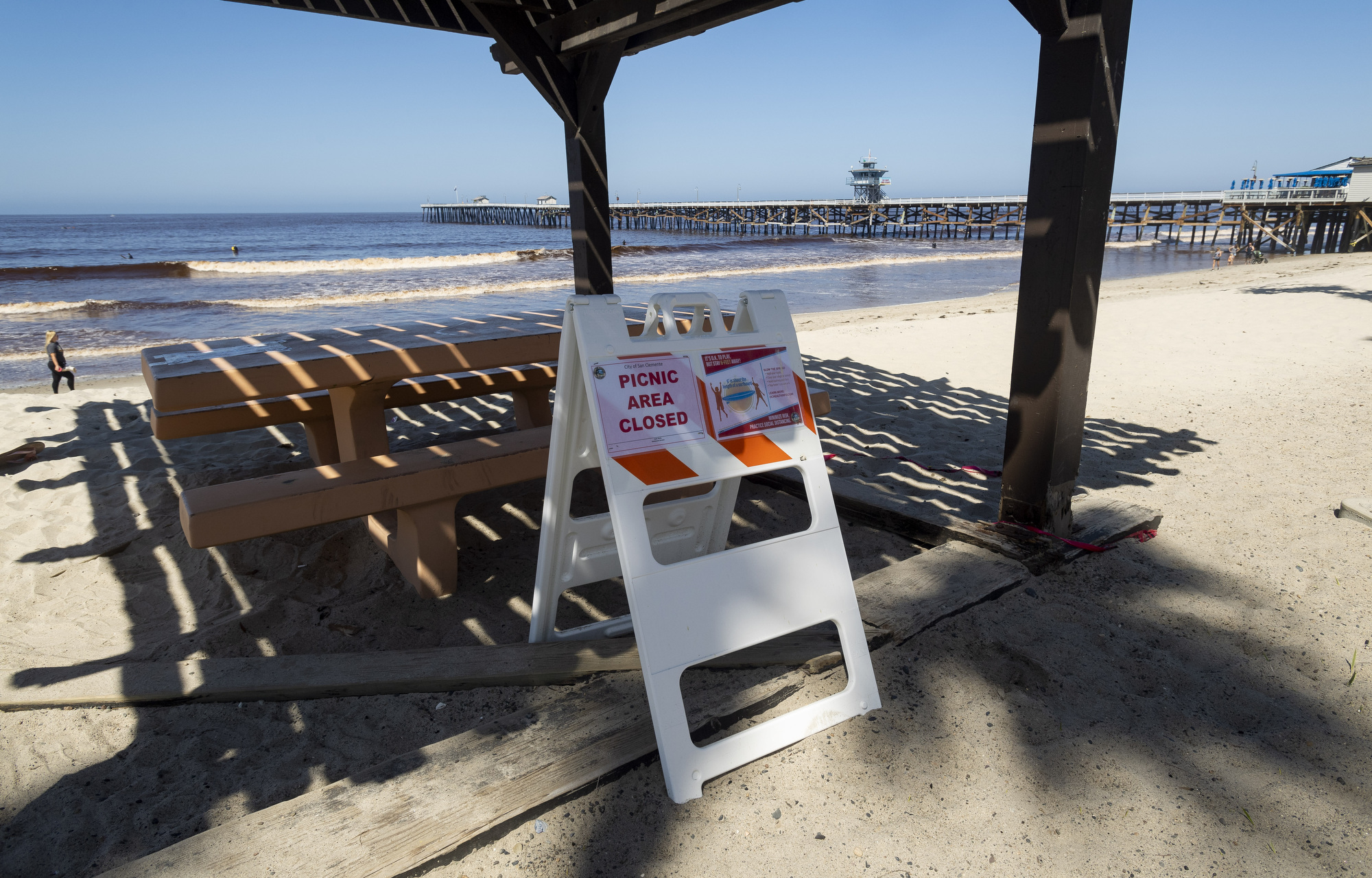 Eight Protesters Arrested After Storming Fencing at San Clemente Beach