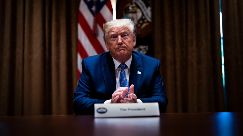 "In this June 15, 2020, file photo, U.S. President Donald Trump listens during a roundtable on ""Fighting for America's Seniors"" at the Cabinet Room of the White House in Washington, DC."