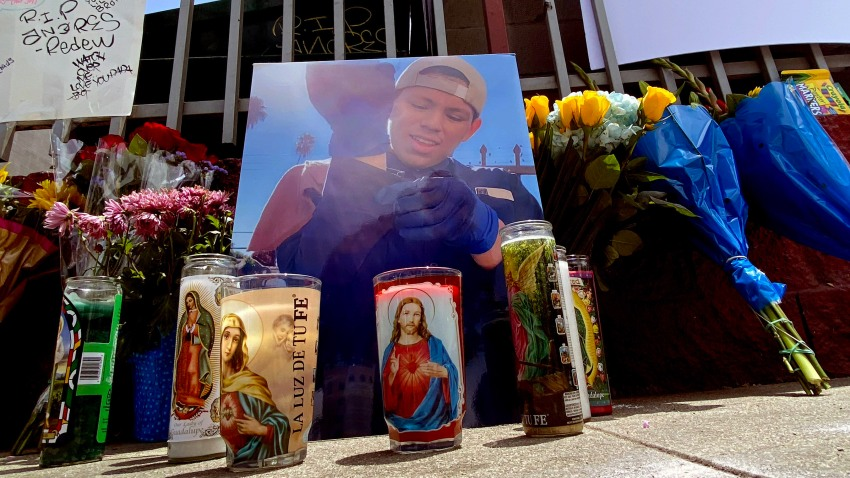 Pictures, candles and notes appear at a memorial for Andres Guardado.