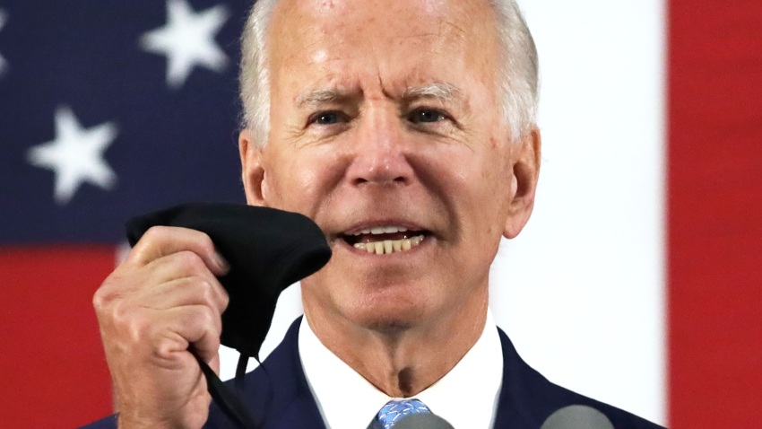 Democratic presidential candidate, former Vice President Joe Biden holds up a mask as he speaks during a campaign event June 30, 2020 at Alexis I. Dupont High School in Wilmington, Delaware. Biden discussed the Trump Administration's handling of the COVID-19 pandemic. (