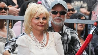 Jim Bakker is asking a judge to dismiss a state lawsuit accusing him of falsely claiming that a health supplement could cure the coronavirus. In this photo televangelist Jim Bakker and wife Lori Bakker attend the ceremony honoring BeBe Winans and CeCe Winans with a star on the Hollywood Walk of Fame on Oct. 20, 2011.