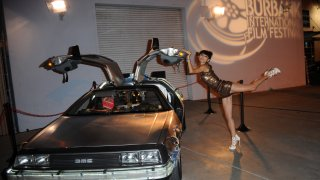 actress at Burbank Film Festival near DeLorean car