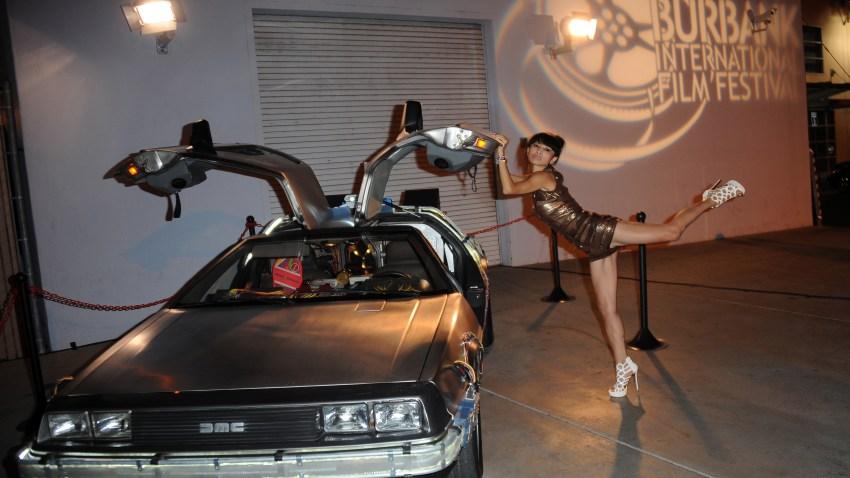 actress at Burbank Film Festival near DeLorean car