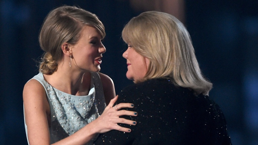 Honoree Taylor Swift accepts the 50th Anniversary Milestone Award for Youngest ACM Entertainer of the Year from her mother, Andrea Finlay, during the 50th Academy of Country Music Awards at AT&T Stadium on April 19, 2015, in Arlington, Texas.