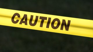 In this Oct. 1, 2015, file photo, caution sign tape is photographed against a black background.