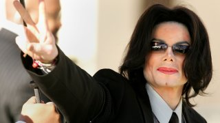 In this March 7, 2005, photo, singer Michael Jackson walks into the Santa Maria Superior Court on the fifth day of his child molestation trial in Santa Maria, California. Jackson is charged in a 10-count indictment with molesting a boy, plying him with liquor and conspiring to commit child abduction, false imprisonment and extortion. He has pleaded innocent.