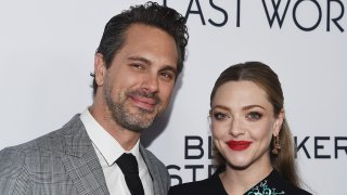 "In this March 1, 2017, file photo, actor Thomas Sadoski (L) and actress Amanda Seyfried arrive at the premiere of Bleecker Street Media's ""The Last Word"" at ArcLight Hollywood in Hollywood, California."