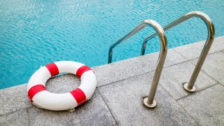 Life ring at swimming pool.emergency tire floating at swimming pool.