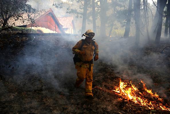 Firefighter dodges flames