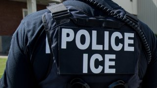 In this June 19, 2018, file photo, U.S. Immigration and Customs Enforcement's (ICE) special agent prepares to arrest alleged immigration violators at Fresh Mark, Salem. Image courtesy ICE ICE / U.S. Immigration and Customs Enforcement.