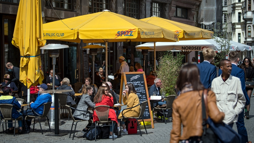 The outdoor seating area of a restaurant on the market square in Leipzig, Germany, sees customers reemerging as coronavirus lockdowns are scaled back.
