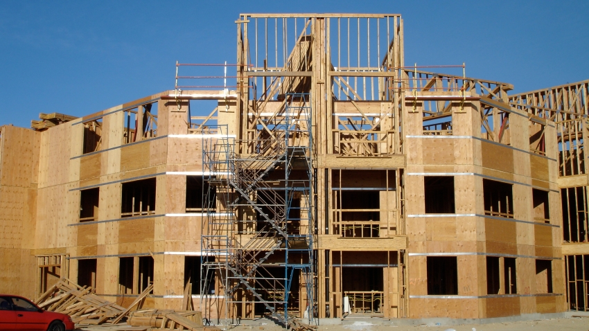 a construction site showing a wooden structure