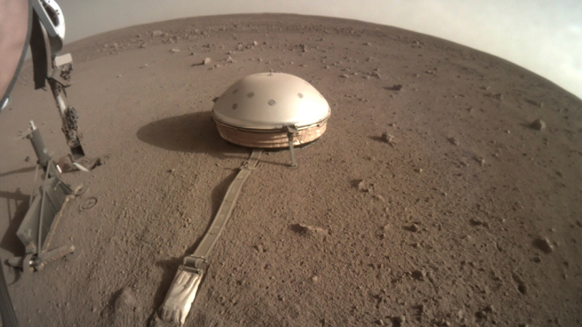 This Feb. 18, 2020 photo made available by NASA shows the InSight lander's dome-covered seismometer, known as SEIS, on Mars.