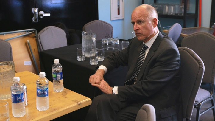 Jerry Brown Sitting at table