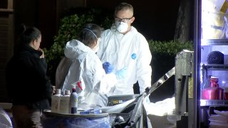 Hazmat investigators work to decontaminate a University City apartment unit where 1.5 million deadly doses of fentanyl were seized.
