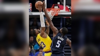 James Leads Lakers Past Magic 96-87