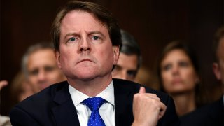 In this Sept. 27, 2018, file photo, White House counsel Don McGahn listens as Supreme court nominee Brett Kavanaugh testifies before the Senate Judiciary Committee on Capitol Hill in Washington.