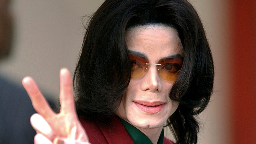 In this Thursday, March 17, 2005, file photo, pop star Michael Jackson acknowledges his fans as he arrives at the Santa Barbara County Courthouse, in Santa Maria, Calif.