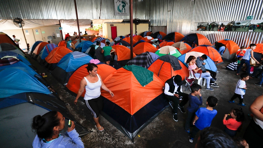 Migrants at a shelter with tents