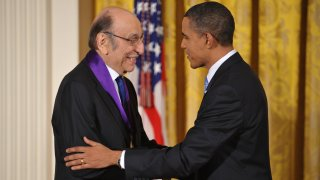In this Feb. 25, 2010, file photo, U.S. President Barack Obama shakes hands with graphic designer Milton Glaser after presenting him with the 2009 National Medal of Arts during a ceremony in the East Room of the White House in Washington, DC.