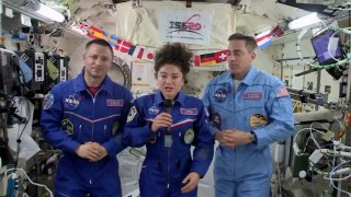 In this April 10, 2020 file image from video made available by NASA, U.S. astronaut Jessica Meir speaks, accompanied by Andrew Morgan and Chris Cassidy, during a news conference held by the American members of the International Space Station.