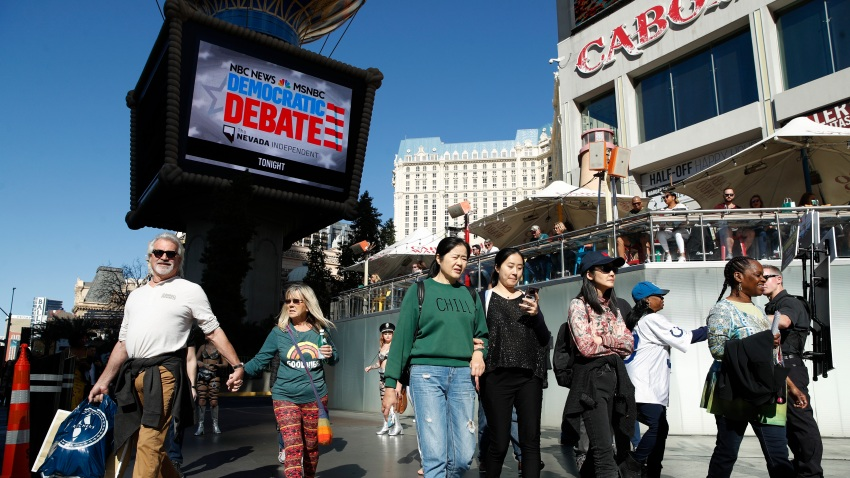 People walk near the Paris Las Vegas hotel casino, site of a Democratic presidential debate, Wednesday, Feb. 19, 2020, in Las Vegas. Nevada's first-in-the West presidential caucus puts the spotlight Saturday on a state that has swung increasingly blue over the last two decades.