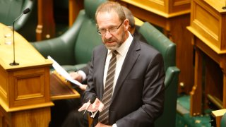New Zealand Justice Minister Andrew Little speaks to lawmakers in Wellington, New Zealand Wednesday, March 18, 2020. Lawmakers voted in favor of a landmark bill that treats abortion as a health issue rather than a crime.