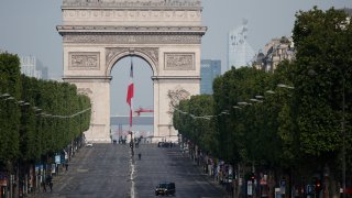 The empty Champs Elysee avenue and the Arc de Triomphe are pictured before VE Day ceremonies Friday May 8, 2020 in Paris.