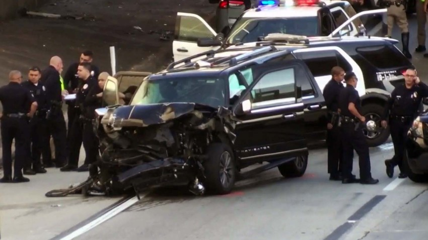A stolen hearse crashed on the 110 Freeway with a body and casket inside.