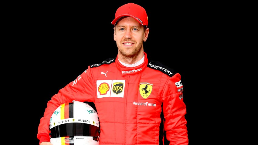 In this March 12, 2020, file photo, Ferrari's German driver Sebastian Vettel poses for a photo at the Albert Park circuit ahead of the Formula One Australian Grand Prix in Melbourne.