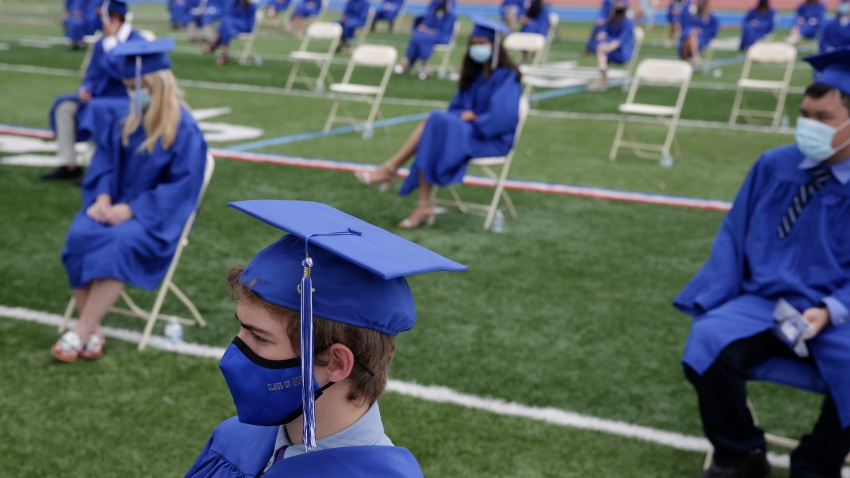 Graduating students practice socially distance by sitting far apart during a graduation ceremony at Millburn High School in Millburn, N.J., Wednesday, July 8, 2020. This week New Jersey saw the resumption of youth day camps, in-person summer school and school graduation ceremonies, capped at 500 people and required to be outside.