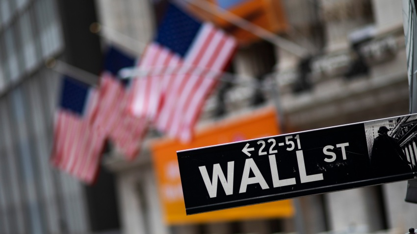 This Jan. 31, 2020, file photo shows a Wall Street sign in front of the New York Stock Exchange.
