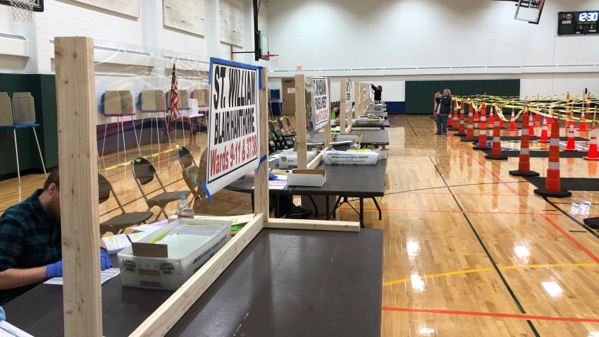 This April 6, 2020 file photo provided by Scott Trindl shows one of the tables, fitted with protective plexiglass, at the sole polling location for city of Waukesha, Wis., residents.