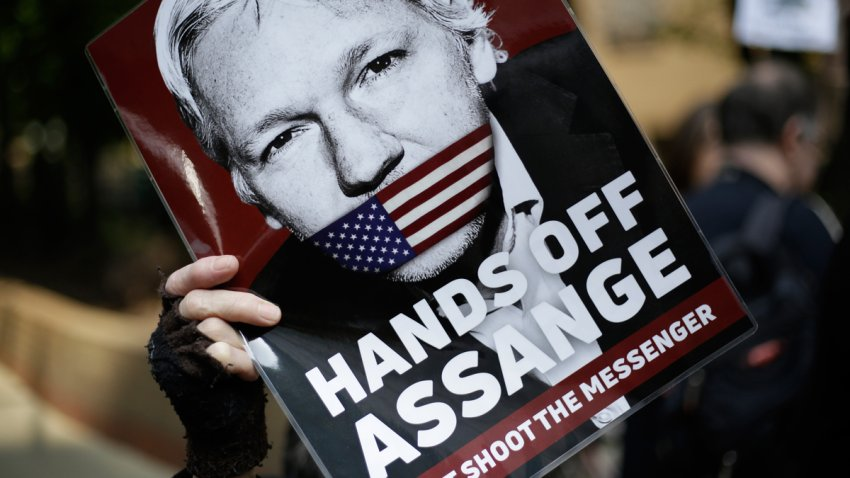 In this May 1, 2019, file photo, protesters demonstrate outside court where Julian Assange will appear in London.