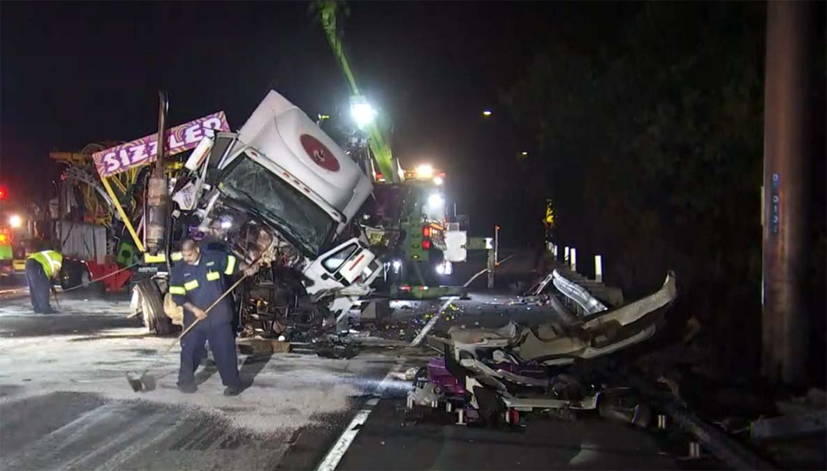 big rig hauling a carnival ride overturns in chain