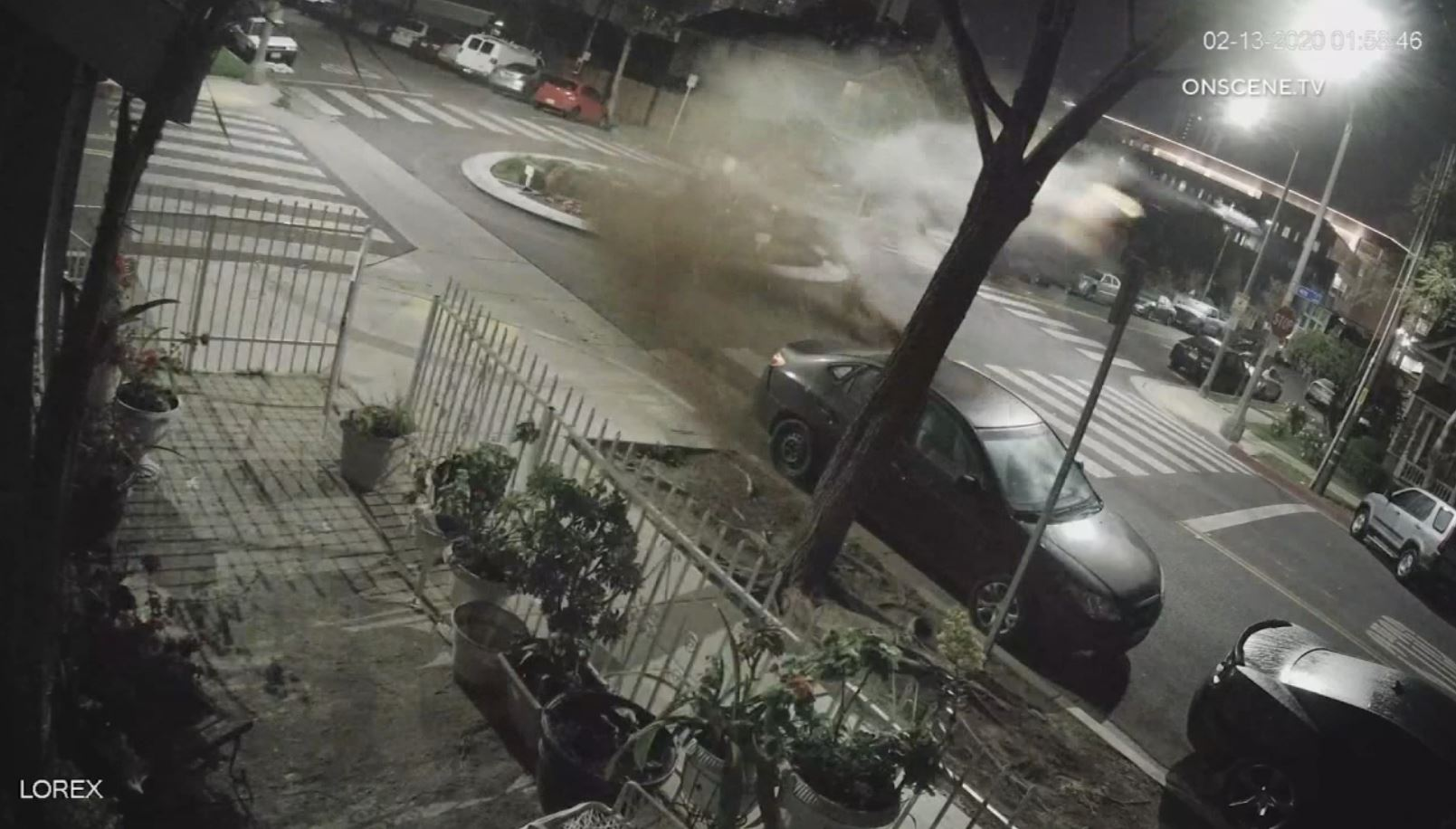 Airborne BMW Soars Over Intersection After Striking a Boulder at High Speed