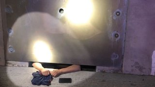 man stuck in drainage tunnel