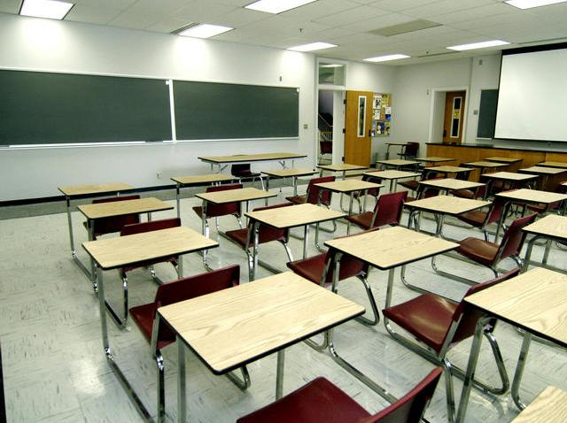 This image shows a generic classroom with desks and a chalkboard.