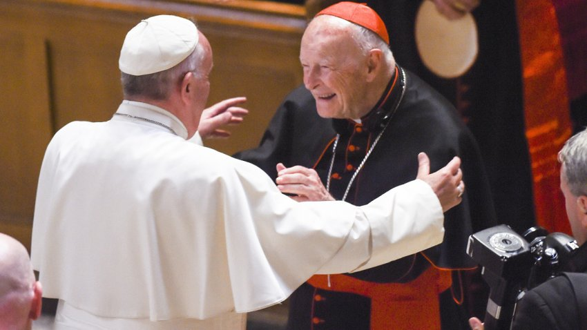 In this Sept. 23, 2015, file photo, Cardinal Archbishop emeritus Theodore McCarrick (C) greets Pope Francis (L) during Midday Prayer of the Divine with more than 300 U.S. Bishops at the Cathedral of St. Matthew the Apostle in Washington, DC.