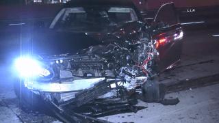 Damaged car with left light completely gone.