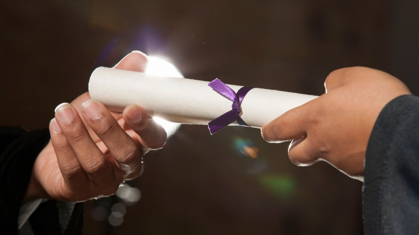 Diploma in hands at graduation ceremony