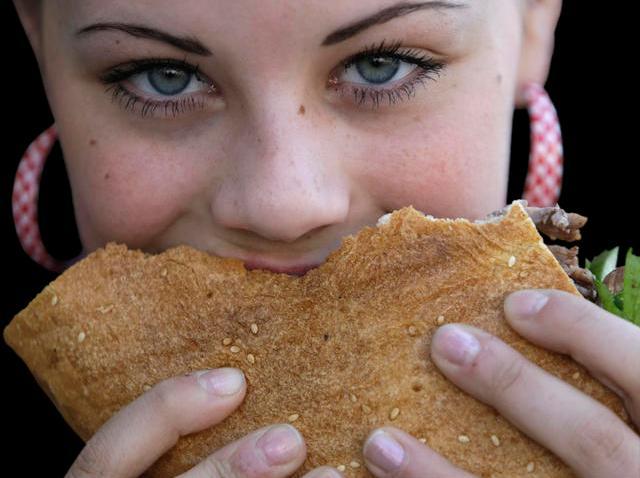 102408 girl eats sandwich