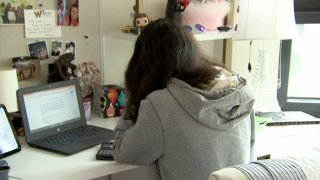 A Chicago student attends a class online during the coronavirus pandemic