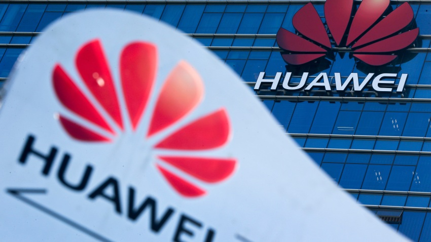 FILE - This Tuesday, Dec. 18, 2018, file photo, shows company signage on display near the Huawei office building at its research and development center in Dongguan, in south China's Guangdong province.