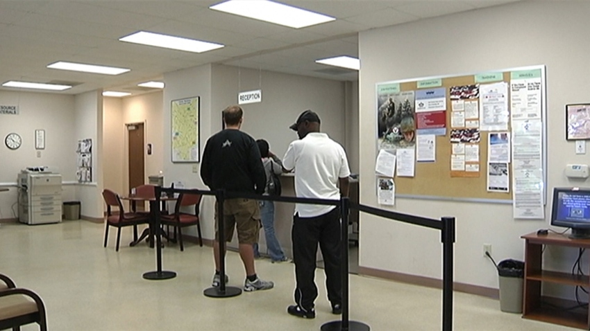 File image of people in line to file at an unemployment center