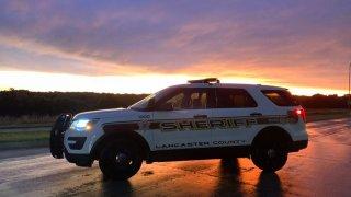 sheriff's vehicle at sunset