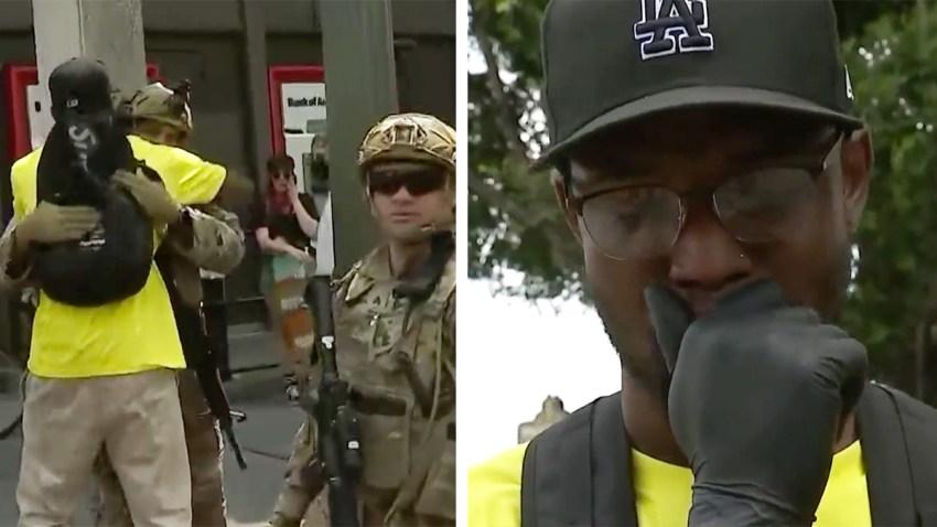 protester hugs national guardsman